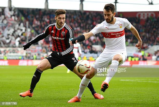 Mathew Leckie of Ingolstadt and Lukas Rupp of Stuttgart tussle for the ball during the Bundesliga match between FC Ingolstadt and VfB Stuttgart at...