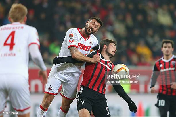 Mathew Leckie of Ingolstadt battles for the ball with Dominic Maroh of Koeln during the Bundesliga match between FC Ingolstadt and 1 FC Koeln at Audi...