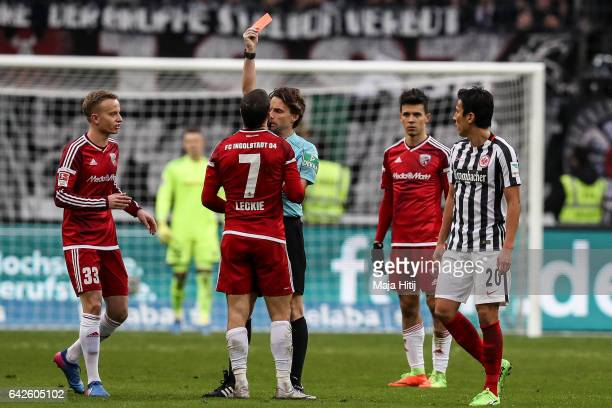 Mathew Leckie of Ingolstadt is shown a red card by referee during the Bundesliga match between Eintracht Frankfurt and FC Ingolstadt 04 at...