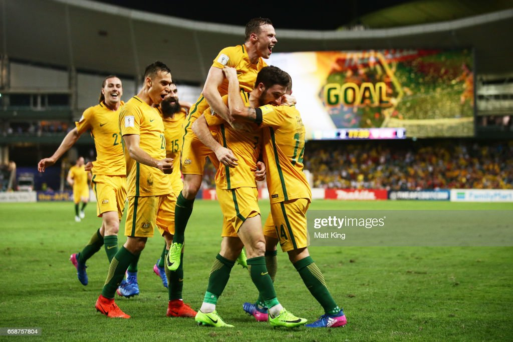 Mathew Leckie of the Socceroos celebrates with team mates after scoring the second goal during the 2018 FIFA World Cup Qualifier match between the Australian Socceroos and United Arab Emirates at Allianz Stadium on March 28, 2017 in Sydney, Australia.