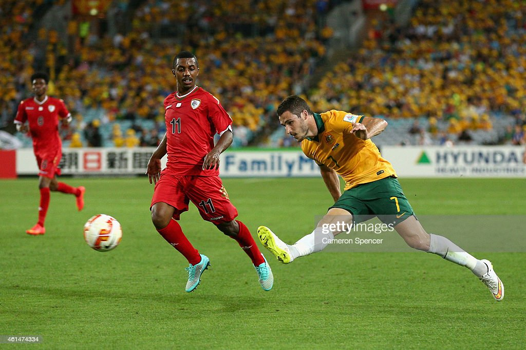 Mathew Leckie of the Socceroos passes during the 2015 Asian Cup match between Oman and Australia at ANZ Stadium on January 13, 2015 in Sydney, Australia.