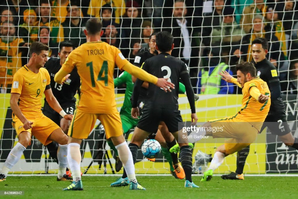 Mathew Leckie of the Socceroos scores their second goal past goalkeeper Sinthaweechai Hathairattanakool of Thailand during the 2018 FIFA World Cup Qualifier match between the Australian Socceroos and Thailand at AAMI Park on September 5, 2017 in Melbourne, Australia.