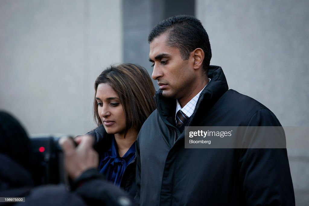Mathew Martoma, a former portfolio manager at a unit of SAC Capital Advisors LP, right, exits federal court in New York, U.S., on Monday, Nov. 26, 2012. Martoma's arrest came six years after he set upon a path that has led him to a choice: one between a trial that may land him in prison for decades, or a deal to implicate others, possibly including SAC founder Steven A. Cohen. Photographer: Scott Eells/Bloomberg via Getty Images