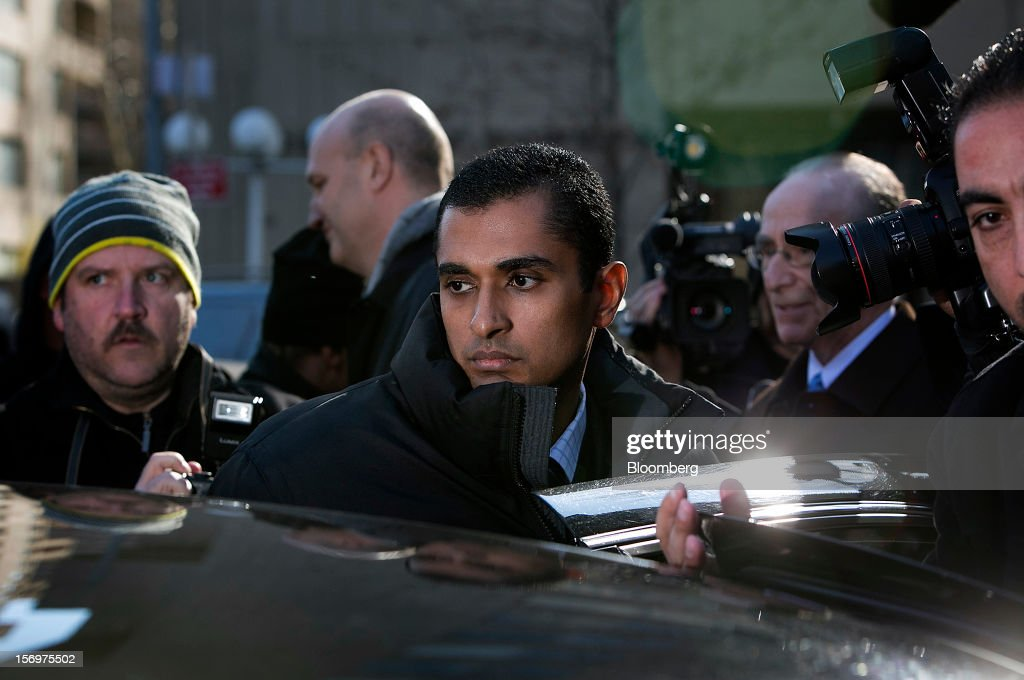 Mathew Martoma, a former portfolio manager at a unit of SAC Capital Advisors LP, center, exits federal court in New York, U.S., on Monday, Nov. 26, 2012. Martoma's arrest came six years after he set upon a path that has led him to a choice: one between a trial that may land him in prison for decades, or a deal to implicate others, possibly including SAC founder Steven A. Cohen. Photographer: Scott Eells/Bloomberg via Getty Images