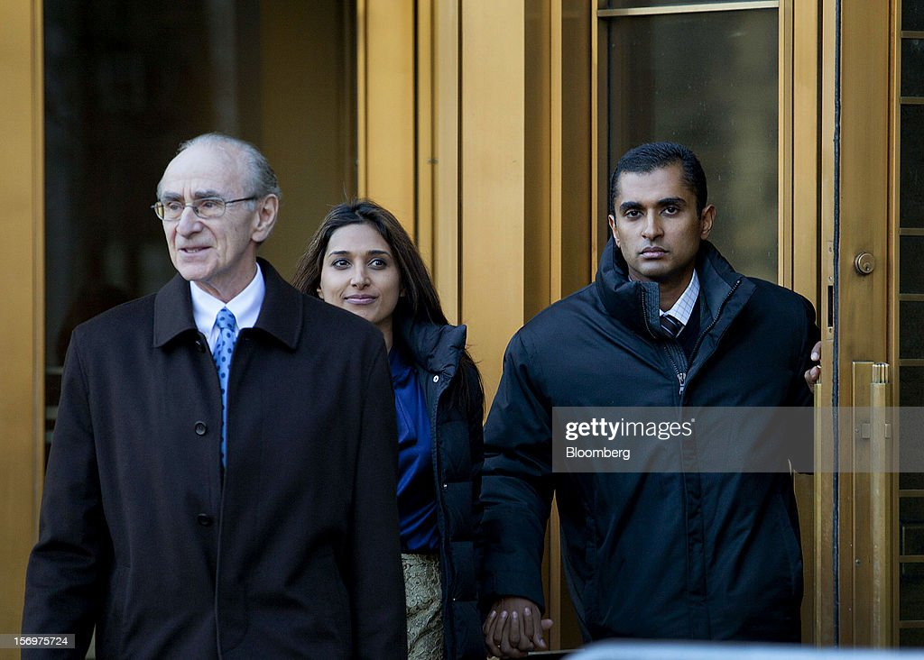 Mathew Martoma, a former portfolio manager at a unit of SAC Capital Advisors LP, right, exits federal court with defense lawyer Charles Stillman, left, in New York, U.S., on Monday, Nov. 26, 2012. Martoma's arrest came six years after he set upon a path that has led him to a choice: one between a trial that may land him in prison for decades, or a deal to implicate others, possibly including SAC founder Steven A. Cohen. Photographer: Jin Lee/Bloomberg via Getty Images
