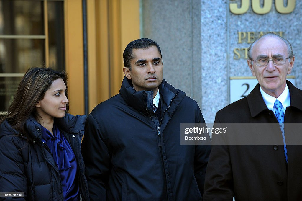Mathew Martoma, a former portfolio manager at a unit of SAC Capital Advisors LP, center, exits federal court with defense lawyer Charles Stillman, right, in New York, U.S., on Monday, Nov. 26, 2012. Martoma's arrest came six years after he set upon a path that has led him to a choice: one between a trial that may land him in prison for decades, or a deal to implicate others, possibly including SAC founder Steven A. Cohen. Photographer: Peter Foley/Bloomberg via Getty Images