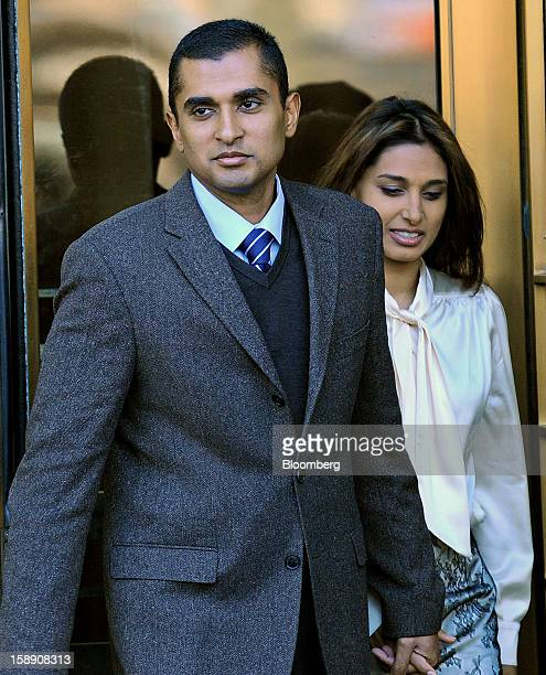 Mathew Martoma a former portfolio manager at a unit of SAC Capital Advisors LP left exits federal court with his wife Rosemary Martoma in New York US...