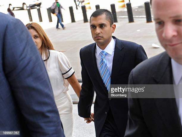 Mathew Martoma a former portfolio manager with SAC Capital Advisors LP center holds hands with his wife Rosemary Martoma as he arrives at federal...