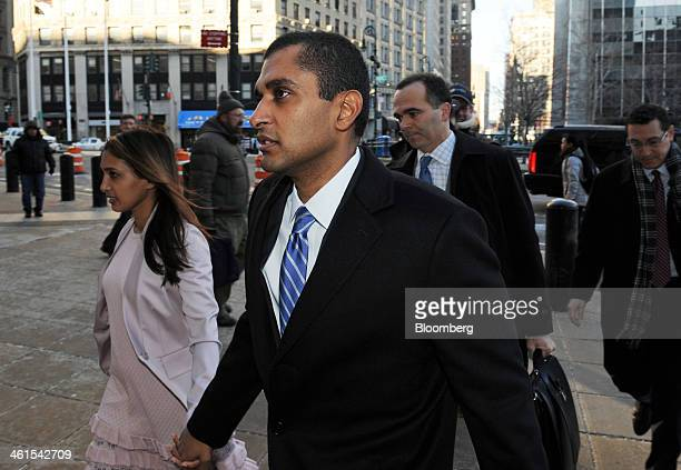 Mathew Martoma a former portfolio manager with SAC Capital Advisors LP center holds hands with his wife Rosemary Martoma as they arrive at federal...