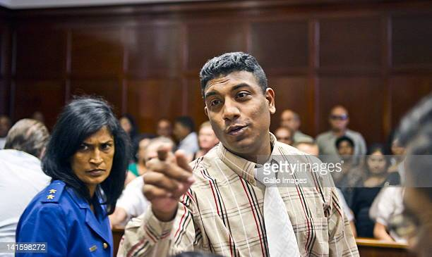 Mathew Naidoo gestures at the Durban High Court on March 19, 2012 in Durban, South Africa; where he received a double life sentence for his part in...