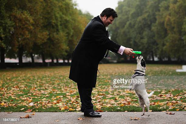Mathew Offord Conservative MP for Hendon plays with his dog Maximus a Jack Russell during the Westminster Dog of The Year competition in Victoria...