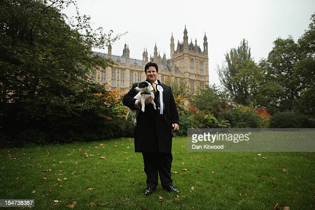 Mathew Offord Conservative MP for Hendon stands in front of The Houses of Parliament with his dog Maximus a Jack Russell during the Westminster Dog...