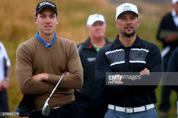 Mathew Perry of New Zealand and Cris Judd wait to tee off during the second round of the New Zealand Open at The Hills Golf Club on February 28 2014...