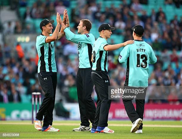 Mathew Pillans of Surrey celebrates taking the wicket of David Lloyd of Glamorgan during the Natwest T20 Blast match between Surrey and Glamorgan at...