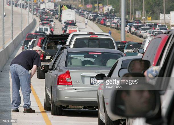 Mathew Rippy of Pasadena talks with a fellow motorist as traffic is at a standstill on FM 1093 September 22 2005 west of Houston Texas Evacuees from...