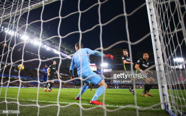 Mathew Ryan Dale Stephens and Tomer Hemed of Brighton and Hove Albion watch the ball as Marcos Alonso of Chelsea scores their second goal during the...