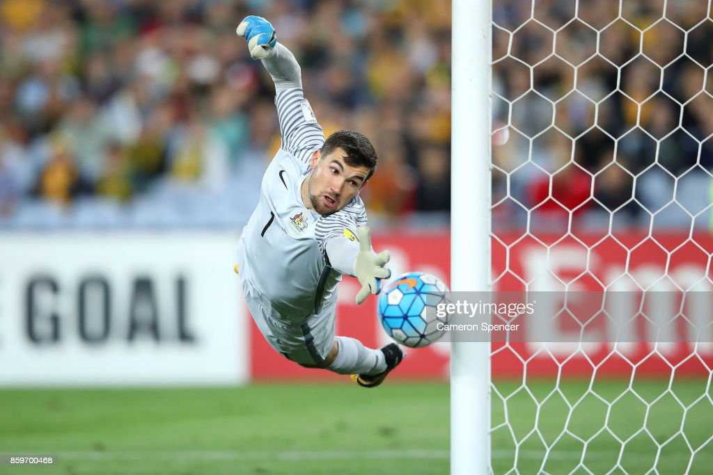 Mathew Ryan of Australia saves a goal during the 2018 FIFA World Cup Asian Playoff match between the Australian Socceroos and Syria at ANZ Stadium on October 10, 2017 in Sydney, Australia.