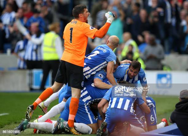 Mathew Ryan of Brighton and Hove Albion and team mates celebrate Anthony Knockaert of Brighton and Hove Albion scoring the first goal during the...