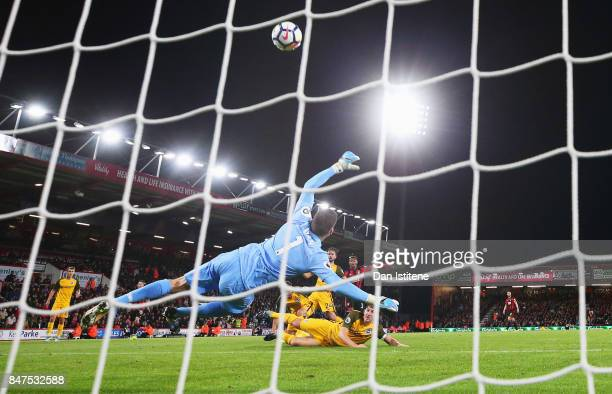 Mathew Ryan of Brighton and Hove Albion dives as Jordon Ibe of AFC Bournemouth misses a chance during the Premier League match between AFC...