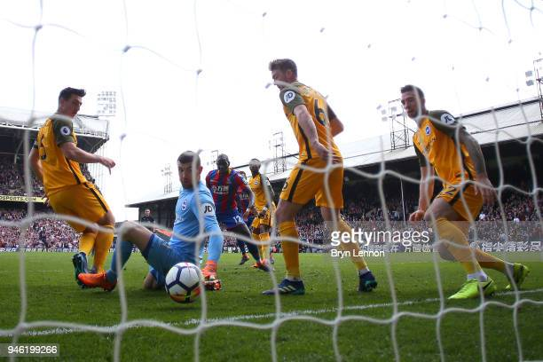 Mathew Ryan of Brighton and Hove Albion looks back as the ball crosses the line for Crystal Palace's second goal scored by James Tomkins of Crystal...