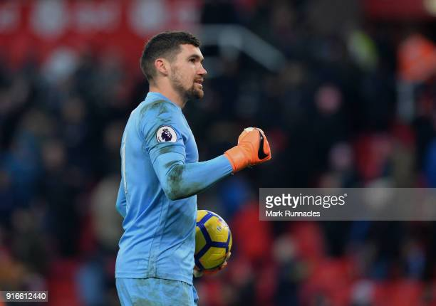 Mathew Ryan of Brighton and Hove Albion reacts at the final whistle after his penalty save in the final moments of the game during the Premier League...