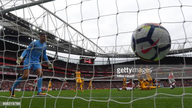 Mathew Ryan of Brighton can only watch as Nacho Monreal scores for Arsenal during the Premier League match between Arsenal and Brighton and Hove...