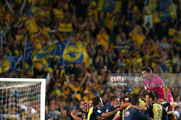 Mathew Ryan of the Mariners celebrates victory after during the ALeague 2013 Grand Final match between the Western Sydney Wanderers and the Central...