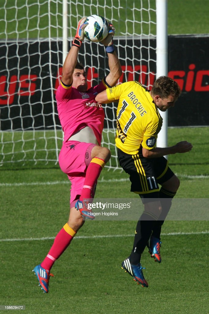 Mathew Ryan of the Mariners makes a save under pressure from Jeremy Brockie of the Phoenix during the round 12 A-League match between the Wellington Phoenix and the Central Coast Mariners at Westpac Stadium on December 22, 2012 in Wellington, New Zealand.