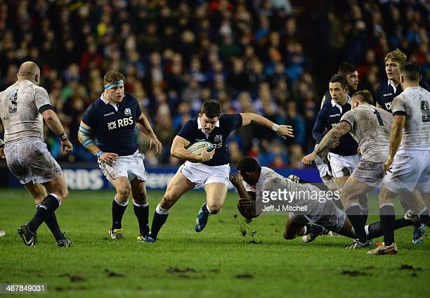 Mathew Scott of Scotland tackles Courtney Lawes England during the RBS Six Nations match between Scotland and England on March 8 2014 in Edinburgh...