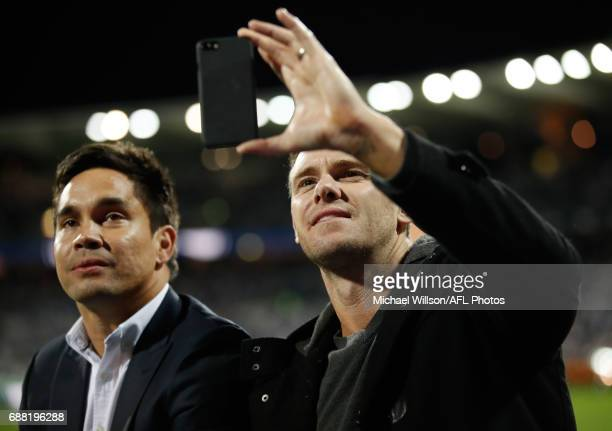Mathew Stokes and Cameron Mooney complete a lap of honour celebrating the 10 year anniversary of the Cats 2007 premiership during the 2017 AFL round...