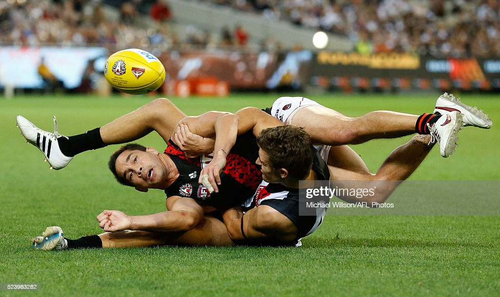 Mathew Stokes of the Bombers is tackled by Adam Oxley of the Magpies during the 2016 AFL Round 05 ANZAC Day match between the Collingwood Magpies and the Essendon Bombers at the Melbourne Cricket Ground, Melbourne on April 25, 2016.