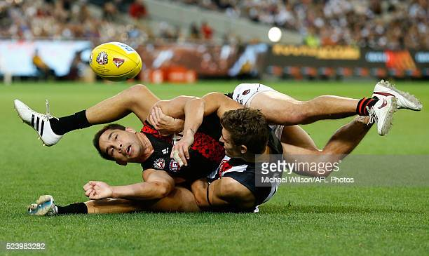 Mathew Stokes of the Bombers is tackled by Adam Oxley of the Magpies during the 2016 AFL Round 05 ANZAC Day match between the Collingwood Magpies and...