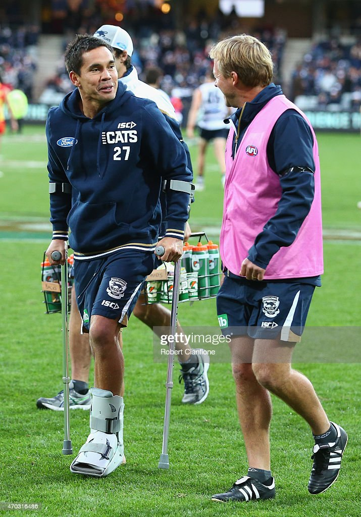Mathew Stokes of the Cats is seen on crutches during the round three AFL match between the Geelong Cats and the Gold Coast Suns at Simonds Stadium on April 19, 2015 in Geelong, Australia.