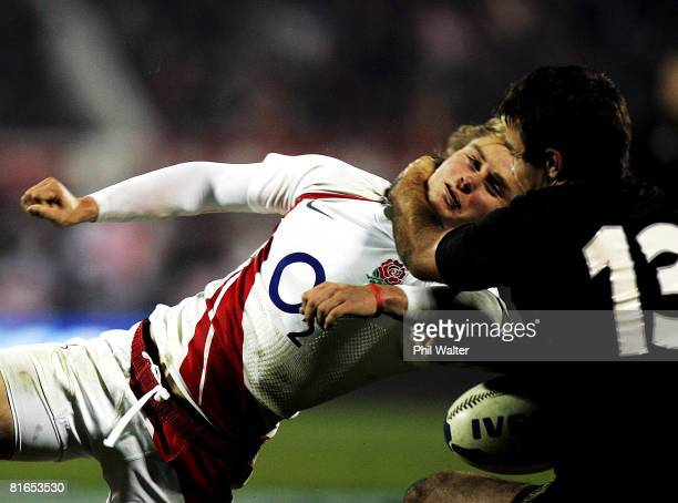 Mathew Tait of England is tackled around the neck by Richard Kahui of the All Blacks during the second Iveco Series test match between the New...