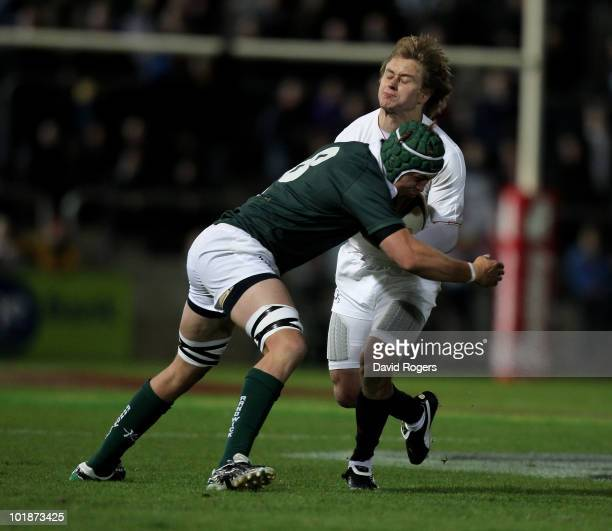 Mathew Tait of England is tackled by Stephen Hoiles during the match between the Australian Barbarians and England at the Members Equity Stadium on...