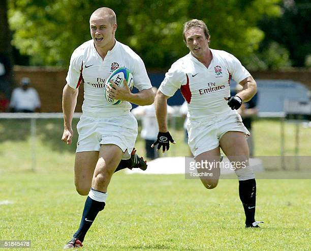 Mathew Tait of England runs with the ball during the match between Ireland and England in the IRB Sevens at Outeniqua Park on December 10 2004 in...