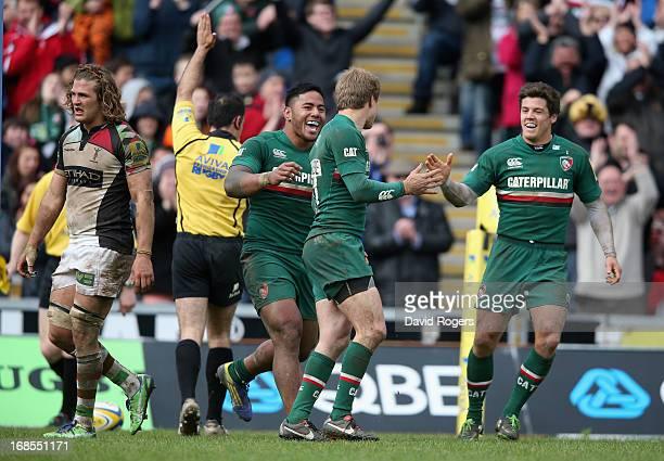 Mathew Tait of Leicester is congratulated by team mates Manu Tuilagi and Anthony Allen after scoring a try during the Aviva Premiership semi final...