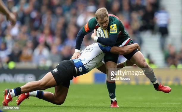 Mathew Tait of Leicester is tackled by Jonathan Joseph during the Aviva Premiership match between Bath Rugby and Leicester Tigers at Twickenham...