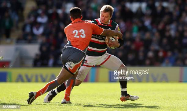Mathew Tait of Leicester is tackled by Zach Kibirige during the Aviva Premiership match between Leicester Tigers and Newcastle Falcons at Welford...