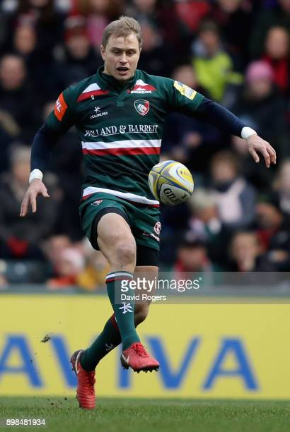 Mathew Tait of Leicester kicks the ball upfield during the Aviva Premiership match between Leicester Tigers and Saracens at Welford Road on December...