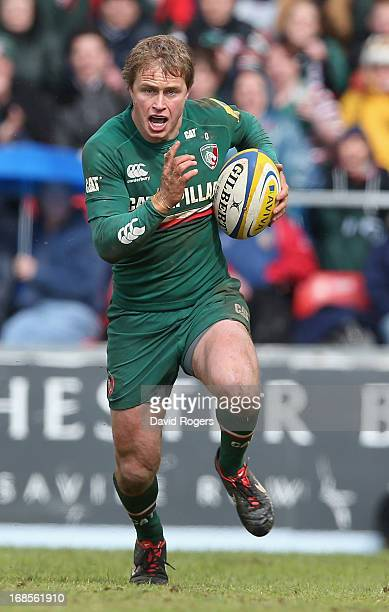 Mathew Tait of Leicester runs with the ball during the Aviva Premiership semi final match between Leicester Tigers and Harlequins at Welford Road on...