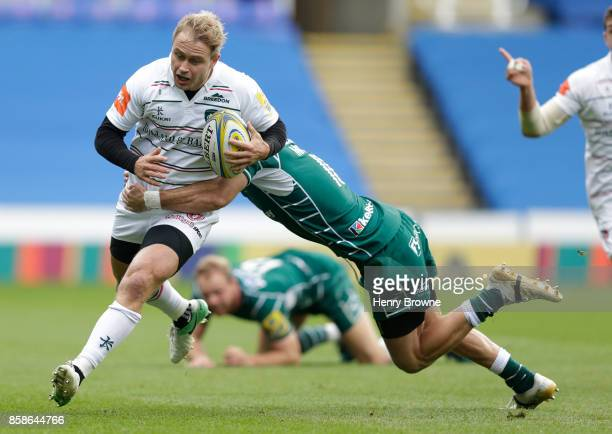 Mathew Tait of Leicester Tigers and James Marshall of London Irish during the Aviva Premiership match between London Irish and Leicester Tigers at...