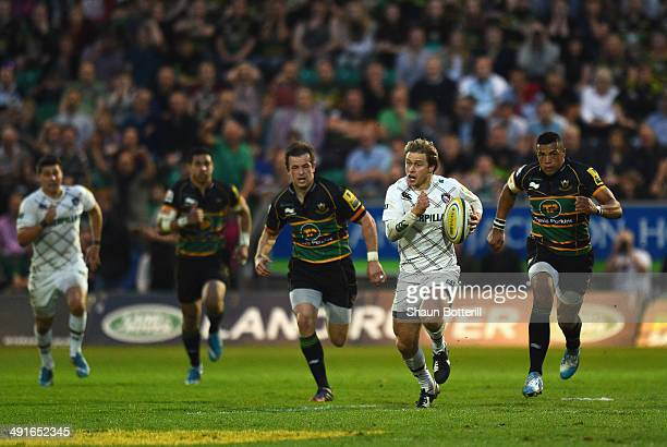 Mathew Tait of Leicester Tigers breaks with the ball during the Aviva Premiership Semi Final match between Northampton Saints and Leicester Tigers at...