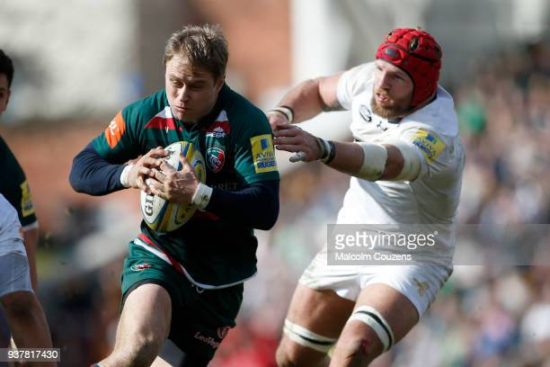 Mathew Tait of Leicester Tigers is tackled by James Haskell of Wasps during the Aviva Premiership match between Leicester Tigers and Wasps at Welford...