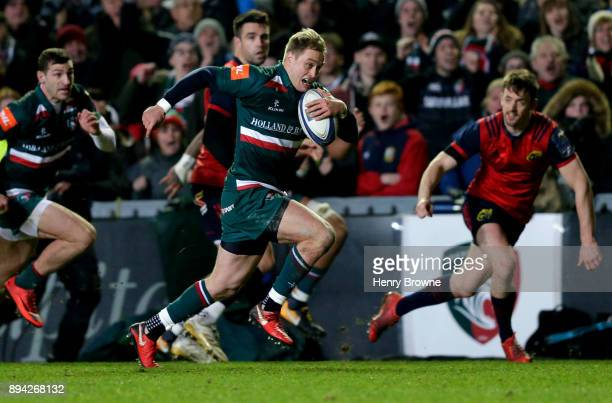 Mathew Tait of Leicester Tigers runs in to score their first try during the European Rugby Champions Cup match between Leicester Tigers and Munster...
