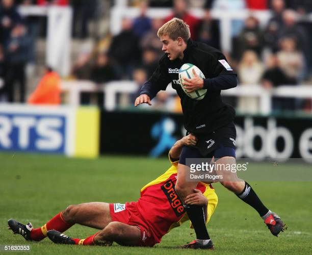Mathew Tait of Newcastle is held by David Marty during the Heineken Cup match between Newcastle Falcons and Perpignan at Kingston Park on October 31...