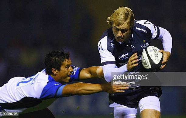 Mathew Tait of Sale breaks through the tackle of Shontayne Hape of Bath during the Guinness Premiership match between Sale Sharks and Bath at Edgeley...