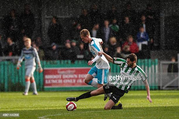 Mathew Wade of Blyth Spartans makes a sliding tackle agains Sean Longstaff of Newcastle for the ball during The Northumberland Senior Cup match...
