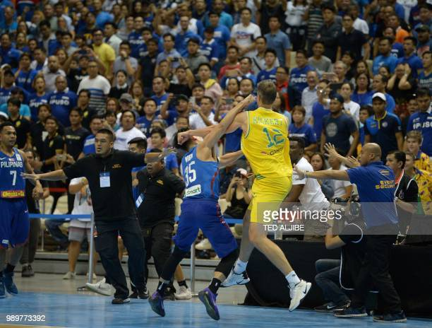 Mathew Wright of the Philipines engage Daniel Kickert of Australia in a brawl during their FIBA World Cup Asian qualifier game at the Philippine...