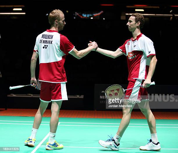Mathian Boe and Carsten Mogensen of Denmark congratulate each other after winning the Men's Doubles Final against Berry Angriawan and Ricky Karanda...